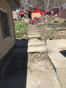 partially ripped up walkway and patio before stamped concrete overlay project